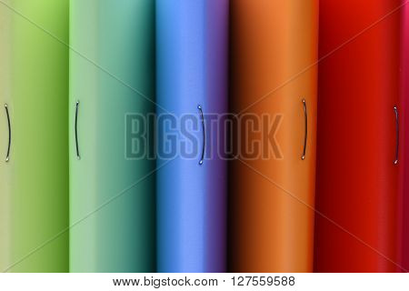 Row of colorful cover exercise book as background