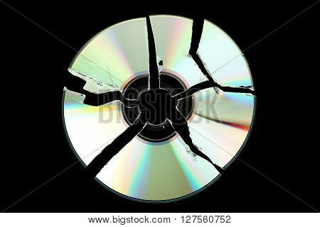 broken cd or dvd isolated on black background