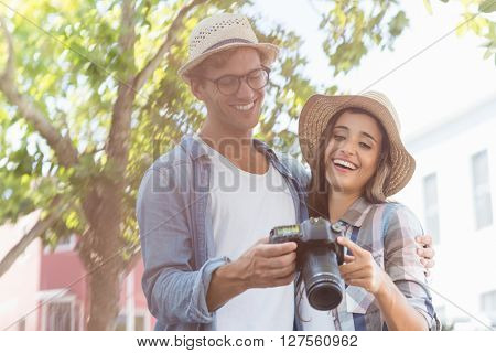 Happy young couple wearing hat looking in camera