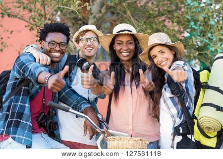 Group of friends giving thumbs up
