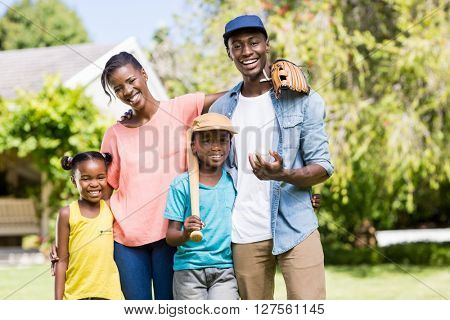 Happy family posing together at the park