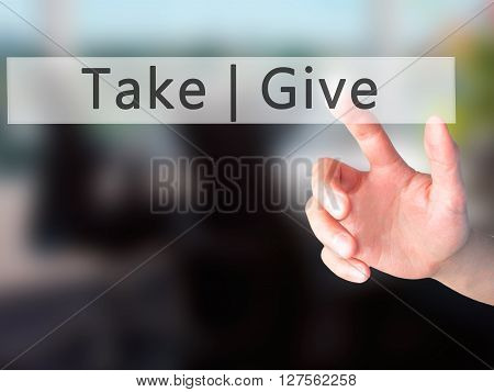 Give  Take - Hand Pressing A Button On Blurred Background Concept On Visual Screen.