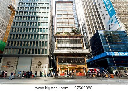 HONG KONG, CHINA - FEB 7, 2016: Business district full of rushing people under modern architecture buildings on February 7, 2016. Hong Kong dollar is the eighth most traded currency in the world.