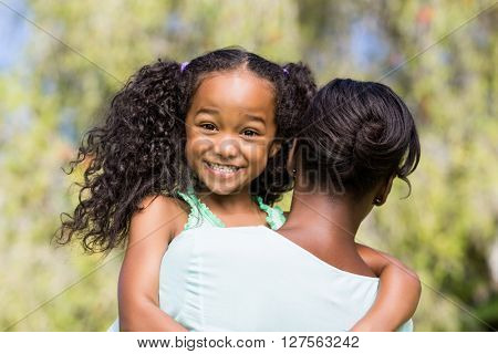 A daughter having hug at park