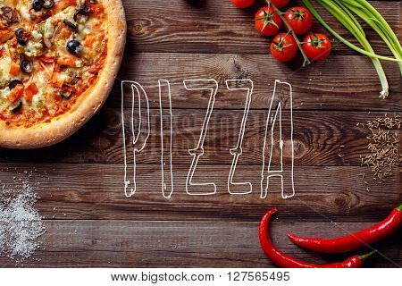 Italian pizza with tomatoes on a wooden table, top view, close-up. Pizza text on center.