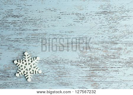 Winter background with snowflake on wooden background