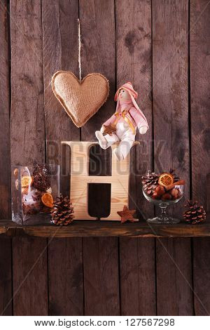 Toy bunny with letter on wooden background