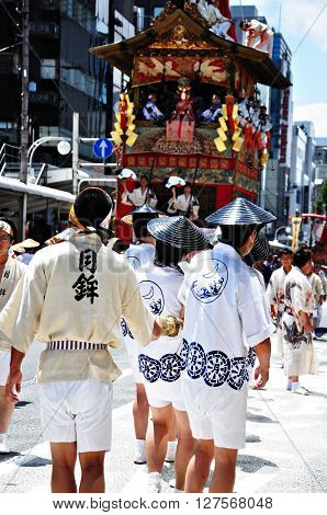 KYOTO - JULY 17: Participants of Gion Festival (Gion Matsuri) pulling a huge float on July 17 2011 in Kyoto Japan. Gion festival is one of the most famous festivals in Japan.
