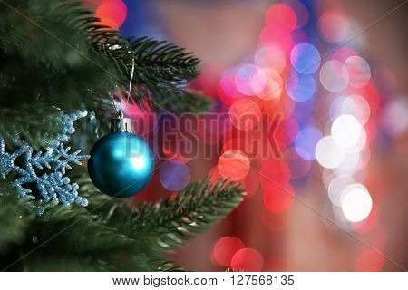 Christmas tree with decor on bright background, closeup