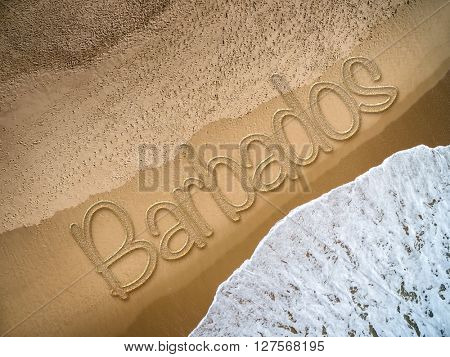 Barbados written on the beach