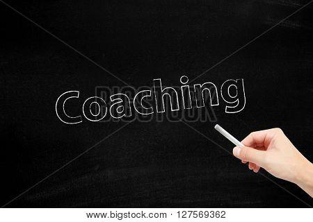 Coaching written with chalk