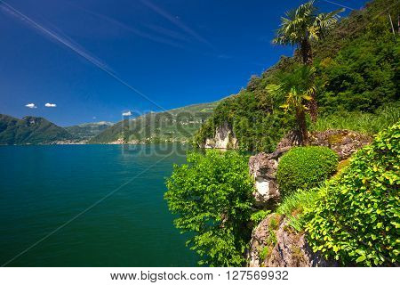 View to lake Como and Alpine mountains in Lombardy region Italy