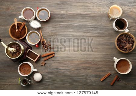 Delicious fresh coffee with spices on wooden table, top view