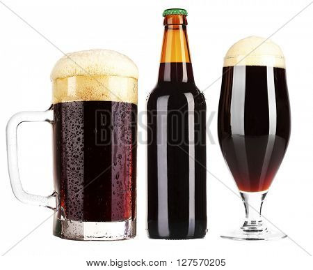 Different types of  dark beer in glass, mug and bottles, isolated on white