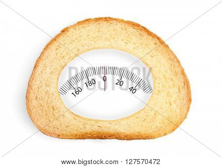 Slice of wheat bread with weights range isolated on white. Health and diet concept