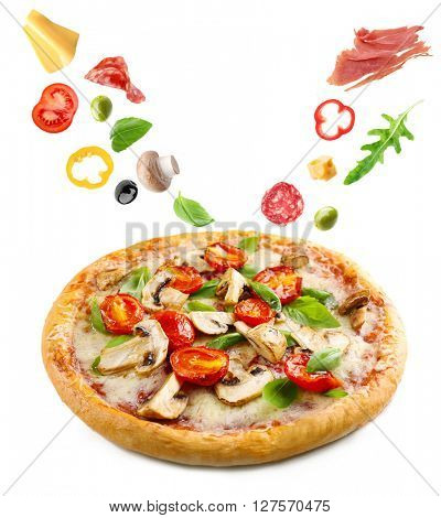 Delicious pizza with falling vegetables and pieces of meat, isolated on white