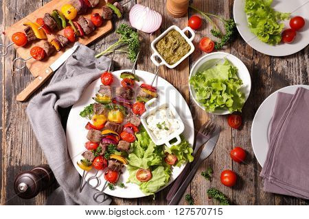 fried beef with salad