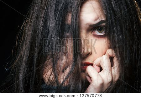 Fashion portrait of emotional woman in the dark