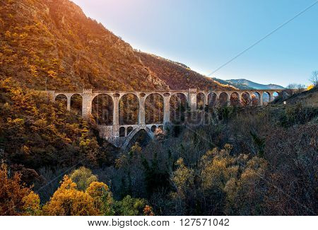 Bridge in the French Pyrenees and picturesque view of mountain range
