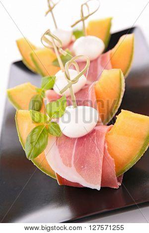 melon ith prosciutto ham and mozzarella