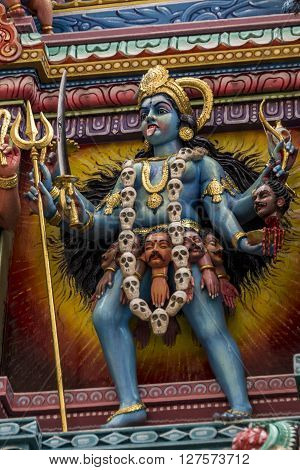 Statue of the hindu god, Kali - detail from a Hindu temple