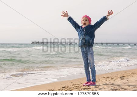 Seven-year Girl Rejoices Arrival Of The Sea