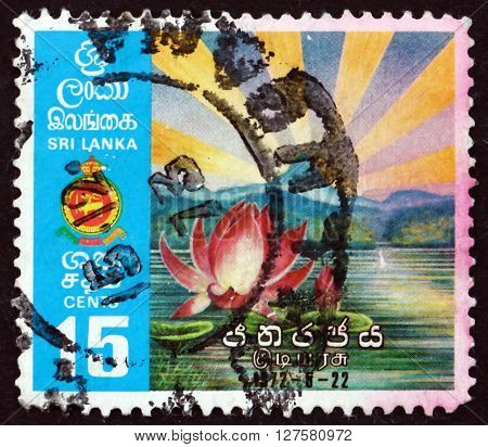 SRI LANKA - CIRCA 1972: a stamp printed in Sri Lanka shows Lotus and Sunrise over Adam's Peak, Inauguration of Ceylon as Republic of Sri Lanka, circa 1972