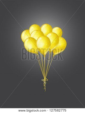 Bunch of golden shimmering balloons on dark background