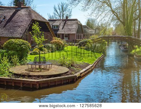 Spring in Giethoorn, a small village in Overijssel province in the Netherlands. Part of the village has no car roads and some houses are accessible by boat only.