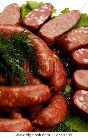 sausage and vegetables on leaves of lettuce