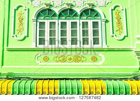 Old windows of colonial building facade Sino-Portuguese architecture in Phuket town Thailand - Colorful house frontage old european style