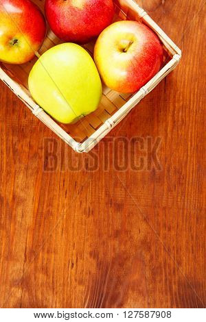 Ripe Apples On A Wooden Table. Free Space For Text. Top View