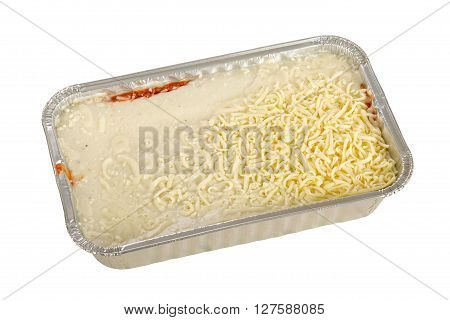 Frozen lasagna in the mold of aluminum on white wooden background.