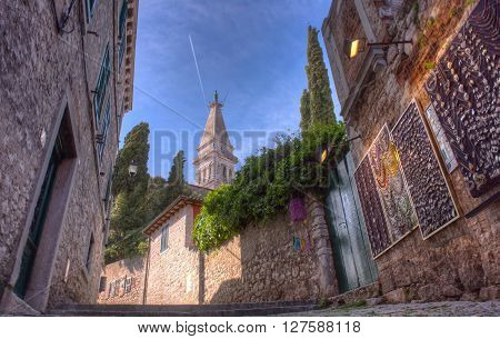 Alley of Rovinj Saint Euphemia's basilica in the background