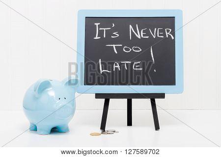 Blue porcelain piggy bank with a message. Concept of saving no matter your age.
