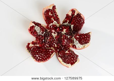 Garnet red sweet ripe on a white background
