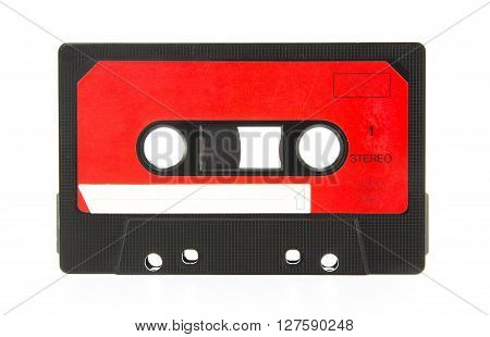 Old audio cassette. Audio cassette isolated on white background