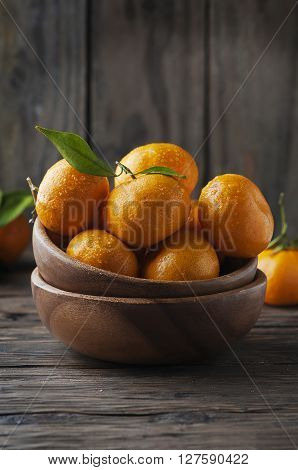 Sweet Fresh Orange Mandarin On The Wooden Table