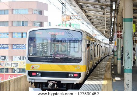 TOKYO, JAPAN - March 31,2016 : JR station platform in Central Tokyo. About 70% of Japan's railway network is operated by the Japan Railways on March 31, 2016.