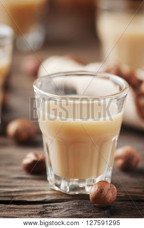 Italian Traditional Hazelnut Liqueur On The Wooden Table