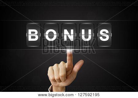 business hand pushing bonus on Flipboard Display