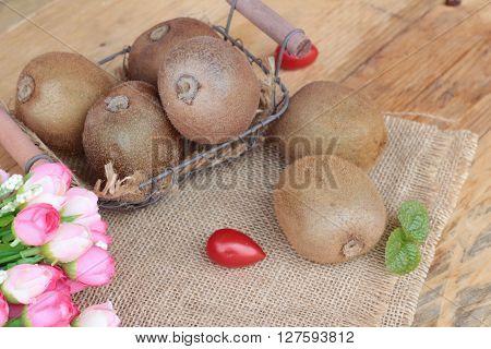 Kiwi fruit juicy is delicious on wood background