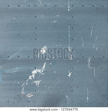 Abstract painted gray metal background. Old texture with rivets.