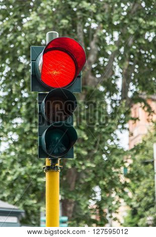 Red traffic signal on the street.