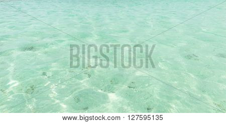 Clear Caribbean sea water surface at Nylon Pool Tobago West Indies shallow depth