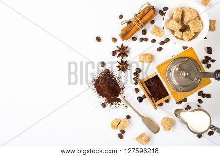 top view ingredients for preparation espresso, milk and sugar on white background with space for text