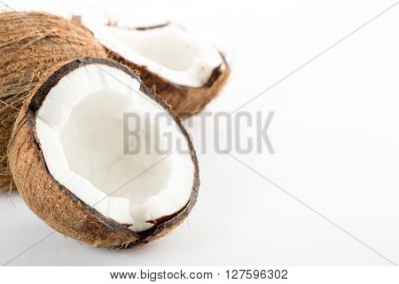 Coconut isolated on white background. Space for text on the right