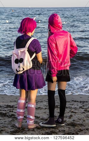 QUARTU S.E., ITALY - August 2, 2015: Beach Cosplay Party - costume parade held at the Marlin Club of Poetto Beach - Sardinia - Group of kids cosplay costume watching the reflections of the sea