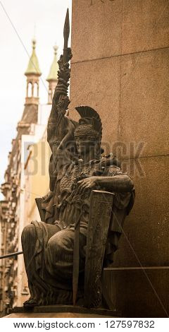 Street corner in buenos aires with a military statue