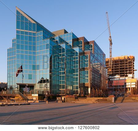 HALIFAX CANADA - APRIL 25 2016: PWC office building. PricewaterhouseCoopers or PWC is the largest professional services firm in the world. PWC headquarters is based in the UK.